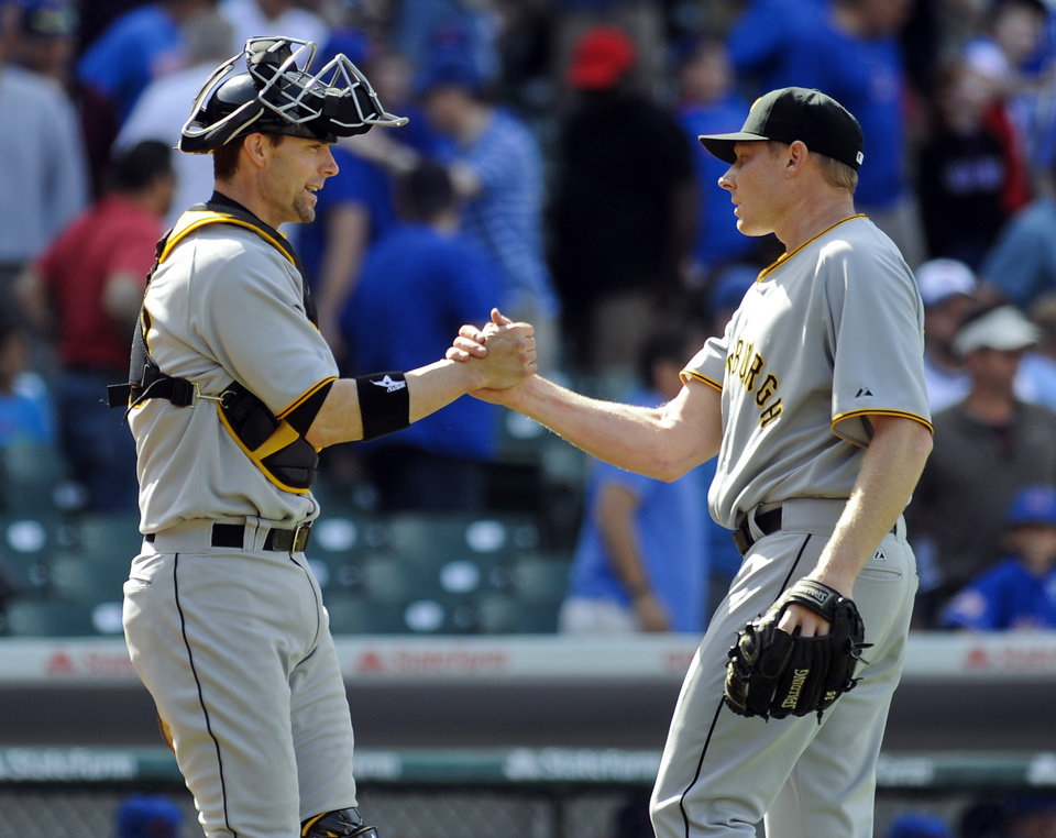 Photo - Pittsburgh Pirates relief pitcher Mark Melancon, right, and Pittsburgh Pirates catcher Chris Stewart congratulate each other after the Pirates defeated the Chicago Cubs 2-1 during a baseball game, Sunday, June 22, 2014, in Chicago. (AP Photo/Matt Marton)