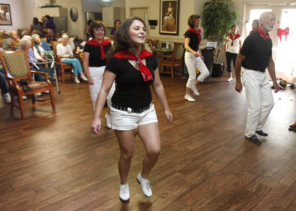 Hillary Dagg, with the Cottonwood Creek Cloggers, performs for residents at Fountain Brook Assisted Living in Midwest City, OK, Thursday, July 19, 2012,  By Paul Hellstern, The Oklahoman