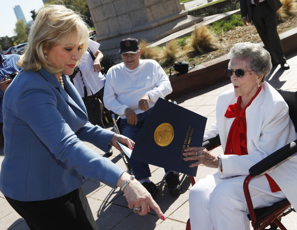 Photo -  Gov. Mary Fallin talks with Gladie Barnwell at the state Capitol as Barnwell is honored with a paver. Photo by K.T. King, The Oklahoman   KT King -