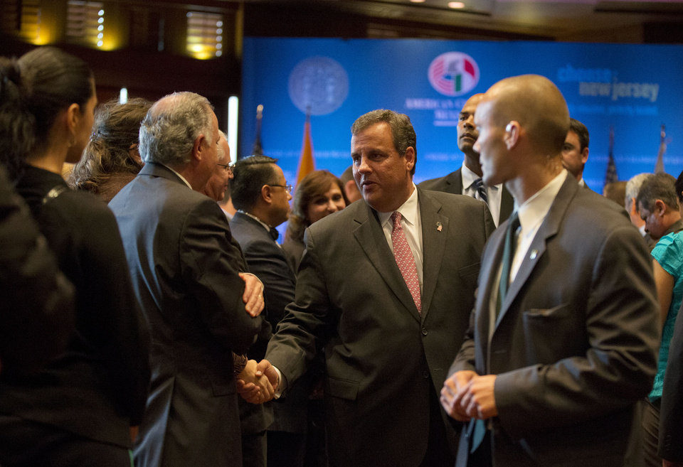 Photo - New Jersey Gov. Chris Christie, center, shakes hands with attendees after giving the American Chamber in Mexico's keynote address, in Mexico City, Wednesday, Sept. 3, 2014. Christie took a spin on the international stage Wednesday, bringing state business to Mexico City and testing his diplomatic savvy as he considers a run for U.S. president in 2016. (AP Photo/Rebecca Blackwell)