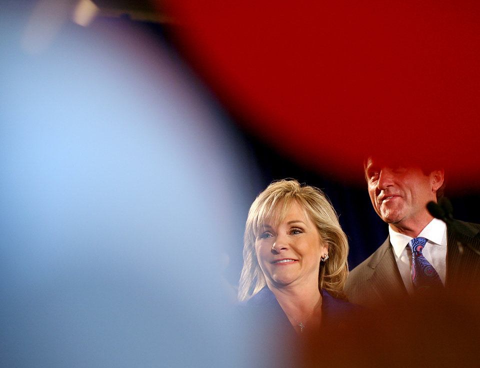 Photo - Governor elect of Oklahoma Mary Fallin and her husband Wade Christensen are surrounded by balloons after she makes her acceptance speech during the Republican Watch Party at the Marriott in Oklahoma City on Tuesday, Nov. 2, 2010.Photo by John Clanton, The Oklahoman