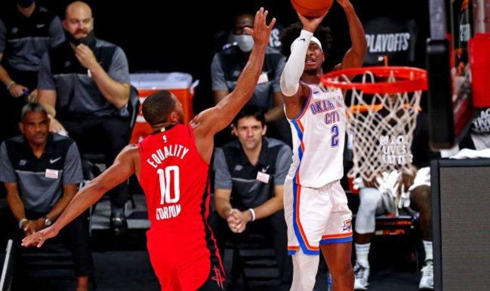 Photo -  Aug 20, 2020; Lake Buena Vista, Florida, USA; Oklahoma City Thunder guard Shai Gilgeous-Alexander (2) shoots the ball against Houston Rockets guard Eric Gordon (10) during the first quarter in an NBA basketball first round playoff game of the 2020 NBA playoffs at AdventHealth Arena. Mandatory Credit: Kim Klement-USA TODAY Sports