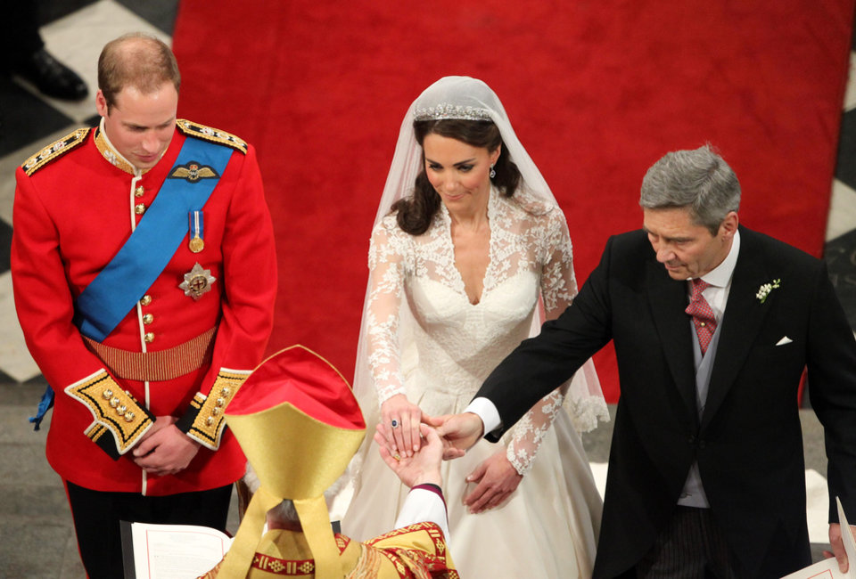 Photo - Prince William and Kate Middleton, with her father Michael, at Westminster Abbey during their wedding service at Westminster Abbey, central London, Friday April 29, 2011. (AP Photo/Andrew Milligan, Pool)  ORG XMIT: RWAJP116