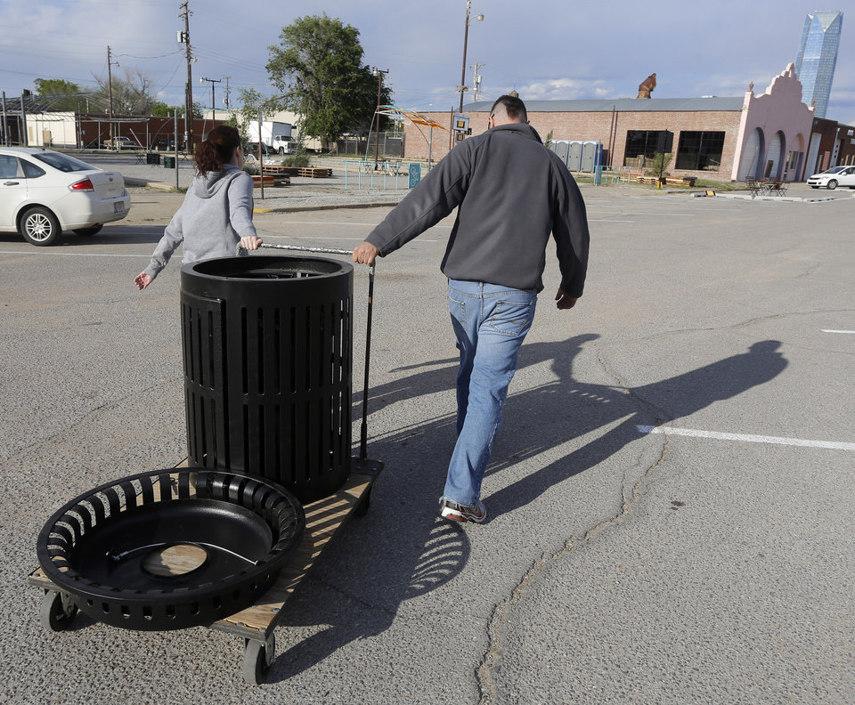 Chris Beumer and Jennifer Gates place trace receptacles