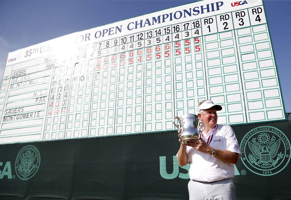 Photo - Colin Montgomerie holds the Francis D. Ouimet trophy following the final round of the U.S. Senior Open golf tournament at Oak Tree National in Edmond, Okla., Sunday, July 13, 2014. Photo by Sarah Phipps, The Oklahoman