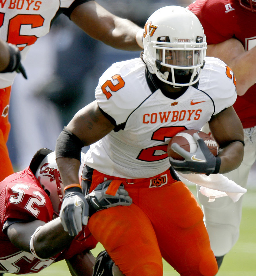 Photo - Beau Johnson of OSU runs past Greg Trent of Washington State during the college football game between Oklahoma State University (OSU) and Washington State at Qwest Field in Seattle, Wash., Saturday, August 30, 2008.  BY BRYAN TERRY, THE OKLAHOMAN ORG XMIT: KOD