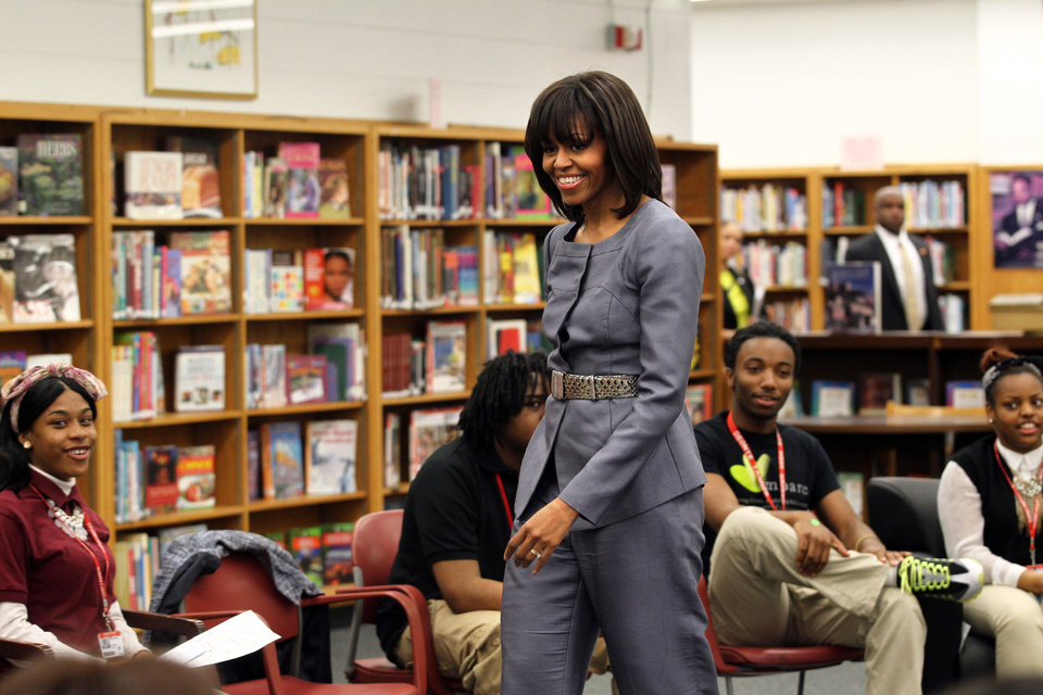 Photo - First Lady Michelle Obama made a style splash with her bangs cut just before the 2012 presidential election. AP Photo.  Nancy Stone