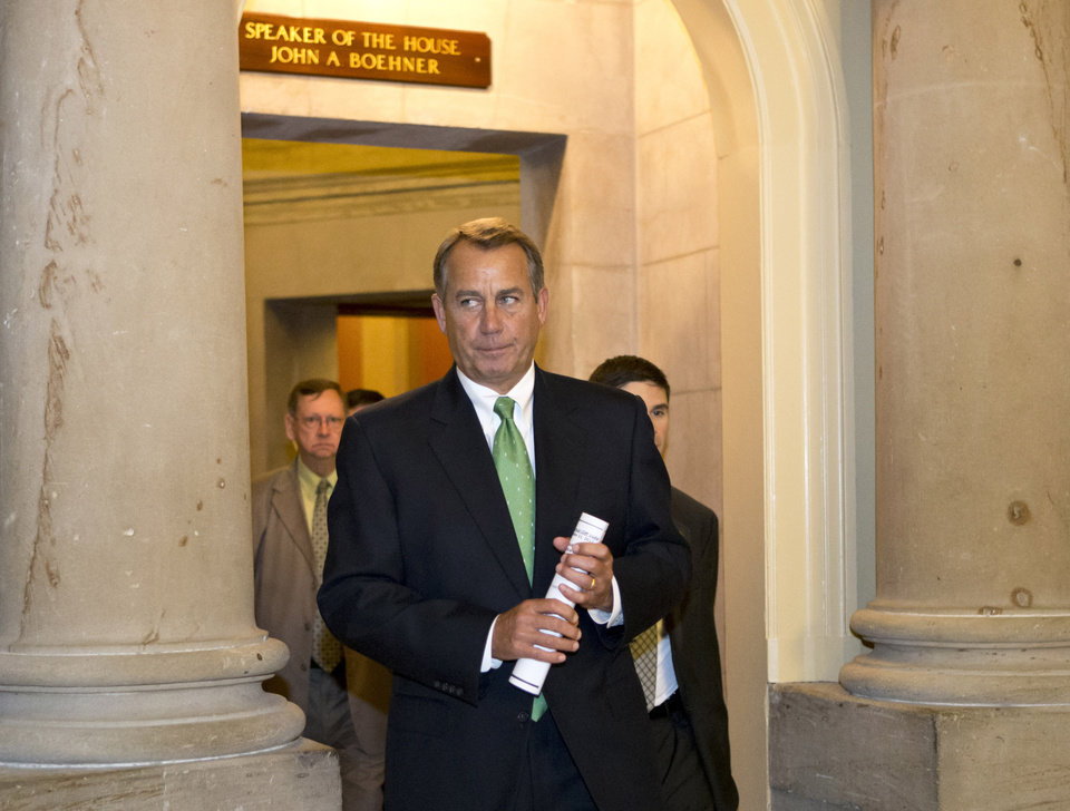 FILE - In this Tuesday, Dec. 11, 2012, file photo, House Speaker John Boehner of Ohio leaves his office and walks to the House floor to deliver remarks about negotiations with President Obama on the fiscal cliff, on Capitol Hill in Washington. Even if Congress and the White House fail to strike a budget deal by New Year\'s Day, reality may be a lot less bleak then the scenario that\'s been spooking employers and investors and slowing the U.S. Economy. The tax increases and spending cuts could be retroactively repealed after Jan. (AP Photo/J. Scott Applewhite)