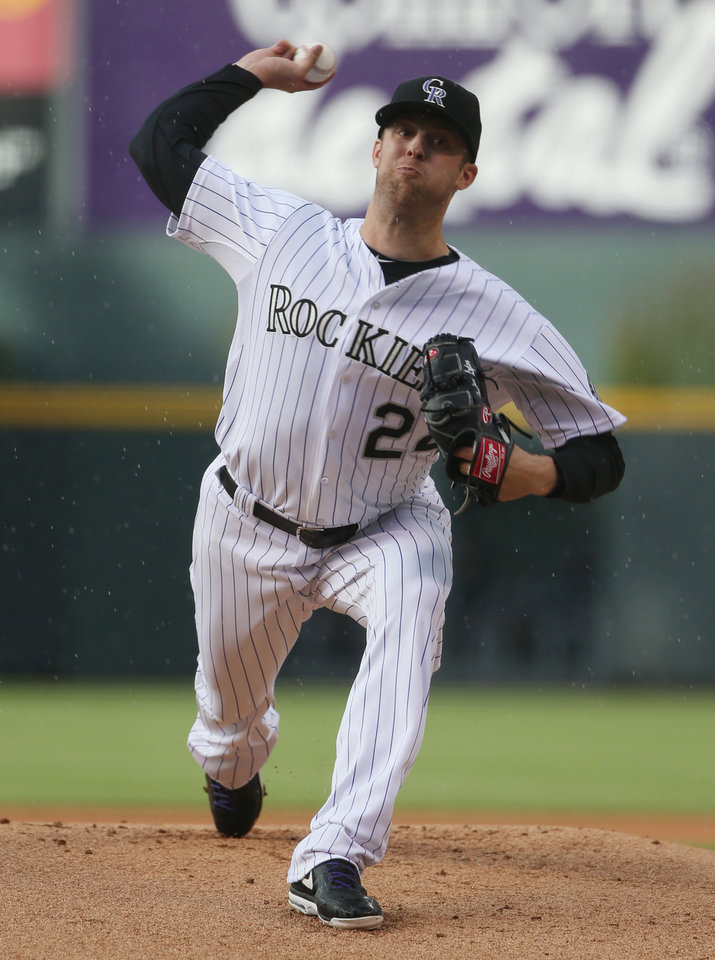 Photo - Colorado Rockies starting pitcher Jordan Lyles works against the San Diego Padres in the first inning of a baseball game in Denver on Saturday, May 17, 2014. (AP Photo/David Zalubowski)