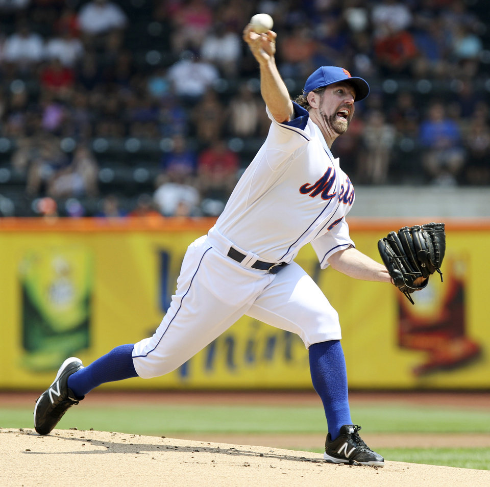 FILE - This Aug. 9, 2012 file photo shows New York Mets\' R.A. Dickey pitching during the first inning of a baseball game against the Miami Marlins at Citi Field in New York. Dickey is a favorite to take home the AL Cy Young Award, Wednesday, Nov. 14, 2012. (AP Photo/Seth Wenig, FIle)