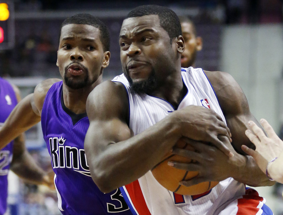 Detroit Pistons guard Will Bynum, right, goes to the basket against Sacramento Kings guard Aaron Brooks (3) in the second half of an NBA basketball game, Tuesday, Jan. 1, 2013, in Auburn Hills, Mich. The Pistons won 103-97. (AP Photo/Duane Burleson)
