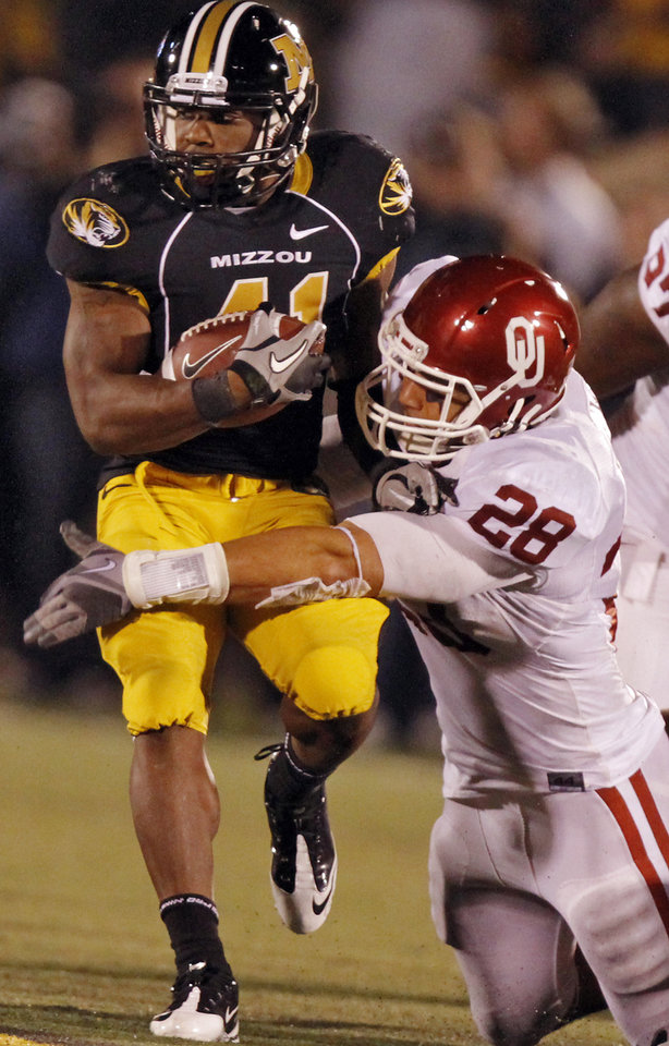 Photo - Oklahoma's Travis Lewis (28) tries to stop Missouri's Henry Josey (41) during the second half of the college football game between the University of Oklahoma Sooners (OU) and the University of Missouri Tigers (MU) on Saturday, Oct. 23, 2010, in Columbia, Mo. Oklahoma lost the game 36-27. Photo by Chris Landsberger, The Oklahoman