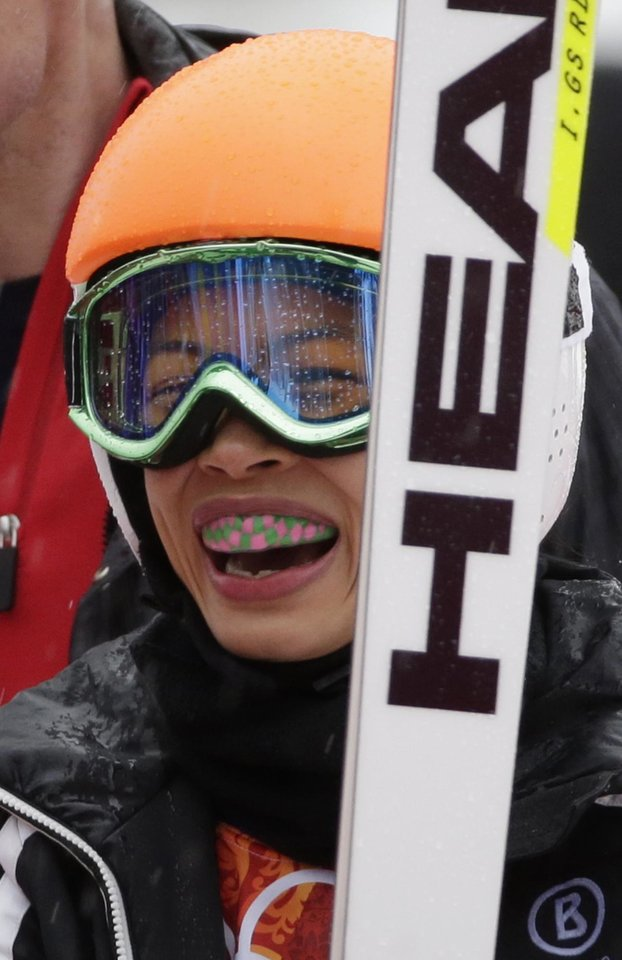 Photo - FILE - In this Tuesday, Feb. 18, 2014 file photo, violinst Vanessa Mae, starting under her father's name as Vanessa Vanakorn for Thailand, smiles after competing in the first run of the women's giant slalom at the Sochi 2014 Winter Olympics in Krasnaya Polyana, Russia. Slovenia said Friday, July 11, 2014 that it has suspended four of its ski officials for allegedly rigging the results of pop violinist Vanessa Mae to help her qualify for the Sochi Winter Olympics. (AP Photo/Gero Breloer, File)
