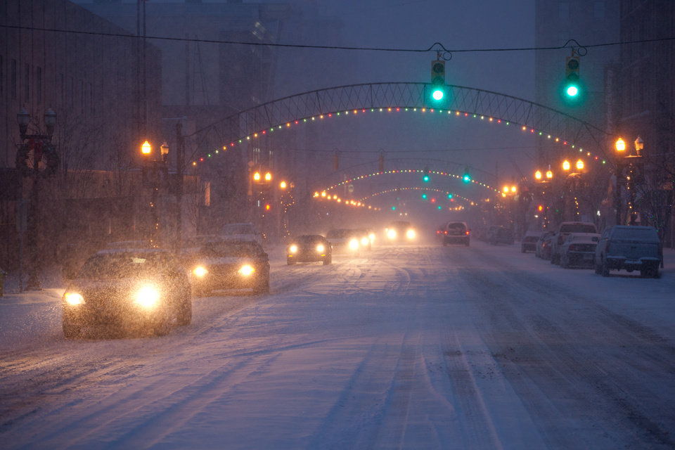 Photo - Commuters drive up and down Saginaw Street on Wednesday, Dec. 26, 2012 in Flint, Mich. Snow began falling around 3pm in Genesee County and a winter weather advisory is in effect until 7am Thursday. Up to four inches of snowfall is expected in the area. (AP Photo/The Flint Journal, Griffin Moores) LOCAL TV OUT; LOCAL INTERNET OUT