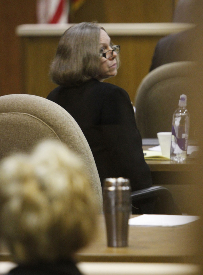 Rebecca Bryan listens to opening statements during her murder trial in the Canadian County Courthouse in El Reno  on May 8. Bryan is accused of killing her husband, Keith Bryan, 52, who was the Nichols Hills fire Chief. Photo By Steve Gooch, The Oklahoman <strong>Steve Gooch</strong>
