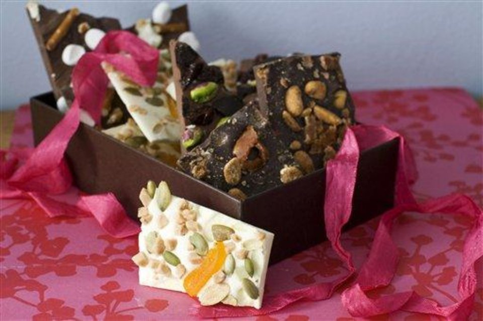 Photo - In this image taken on Jan. 21, 2013, four variations of Valentine's Day chocolate bark are shown in Concord, N.H. You can top the chocolate with whatever your love loves.(AP Photo/Matthew Mead)