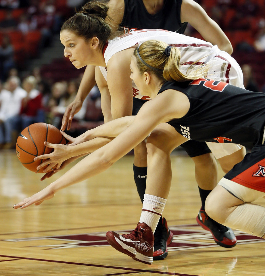 Photo - Oklahoma's Morgan Hook (10) tries to keep the ball away from Cal State Northridge's Marta Masoni (24) in the first half during a women's college basketball game between the University of Oklahoma (OU) and Cal State Northridge at the Lloyd Noble Center in Norman, Okla., Saturday, Dec. 29, 2012. Photo by Nate Billings, The Oklahoman