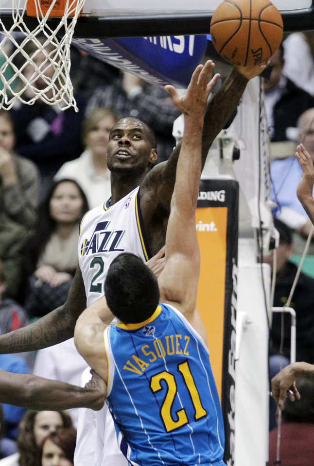 Utah Jazz's Marvin Williams (2) blocks the shot of New Orleans Hornets' Greivis Vasquez (21), of Venezuela, in the second quarter during an NBA basketball game Wednesday, Jan. 30, 2013, in Salt Lake City. (AP Photo/Rick Bowmer)