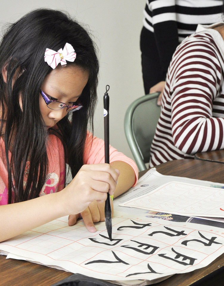 Photo - Anne Hsieh doing calligraphy during Chinese culture classes at Trinity International Baptist Church Sunday, October 6, 2013. Photo by M. Tim Blake, for The Oklahoman