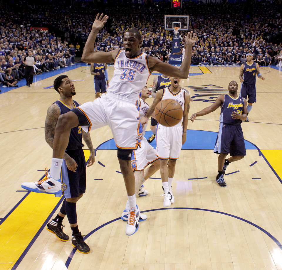 Photo - Oklahoma City's Kevin Durant (35) reacts after a dunk beside Denver's Wilson Chandler (21) during the NBA basketball game between the Denver Nuggets and the Oklahoma City Thunder in the first round of the NBA playoffs at the Oklahoma City Arena, Wednesday, April 27, 2011. Photo by Bryan Terry, The Oklahoman