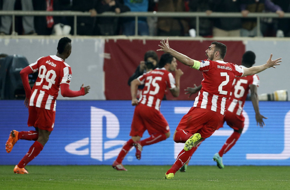 Photo - Olympiakos' players celebrate a goal against Manchester United  during a Champions League, round of 16, first leg soccer match at Georgios Karaiskakis stadium, in Piraeus port, near Athens, on Tuesday, Feb. 25, 2014. (AP Photo/Petros Giannakouris)