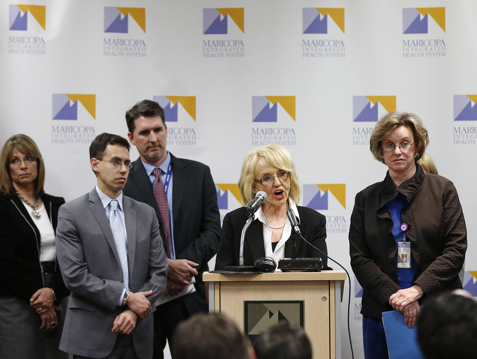 Arizona Gov. Jan Brewer, center,  calls for the expansion of Medicaid, Wednesday, Jan. 26, 2013 in Phoenix with healthcare and business leaders at Maricopa Medical Center. An expansion would call for $8 billion in federal assistance for the State over three years. (AP Photo/Matt York)