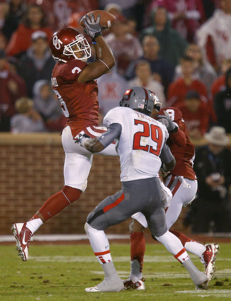 Oklahoma's Sterling Shepard (3) catches a pass over Texas Tech's Olaoluwa Falemi (29) during a college football game between the University of Oklahoma Sooners (OU) and the Texas Tech Red Raiders at Gaylord Family-Oklahoma Memorial Stadium in Norman, Okla., on Saturday, Oct. 26, 2013. Oklahoma won 38-30. Photo by Bryan Terry, The Oklahoman