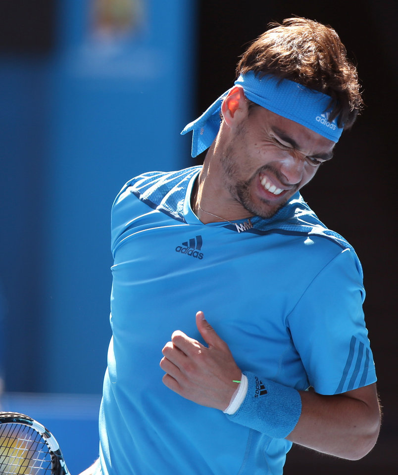 Photo - Fabio Fognini of Italy reacts after losing a point durring his fourth round match against Novak Djokovic of Serbia at the Australian Open tennis championship in Melbourne, Australia, Sunday, Jan. 19, 2014.(AP Photo/Aaron Favila)