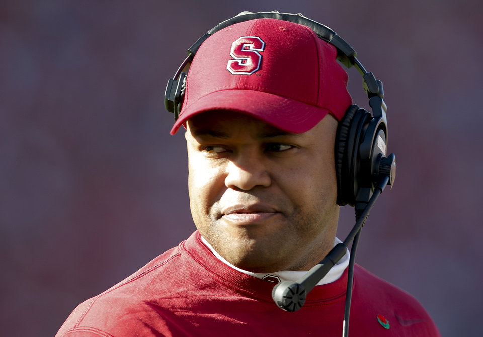 Photo - Stanford head coach David Shaw watches from the sideline during the first half of the Rose Bowl NCAA college football game against Wisconsin, Tuesday, Jan. 1, 2013, in Pasadena, Calif. (AP Photo/Jae C. Hong)