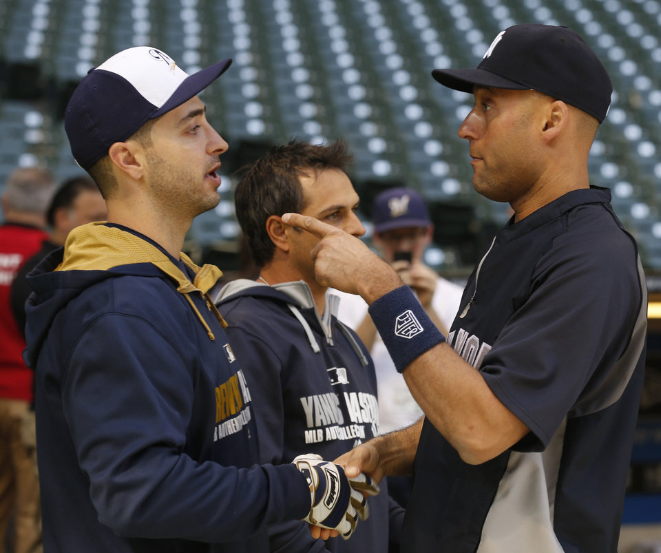 Photo - Milwaukee Brewers' Ryan Braun, left, talks with New York Yankees' Derek Jeter before their baseball game Saturday, May 10, 2014, in Milwaukee. Neither player was in the starting lineup. (AP Photo/Jeffrey Phelps)