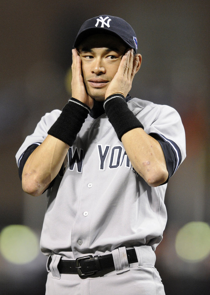 Photo -   New York Yankees left fielder Ichiro Suzuki reacts as teammates are introduced before Game 1 of the American League division baseball series against the Baltimore Orioles on Sunday, Oct. 7, 2012, in Baltimore. (AP Photo/Nick Wass)