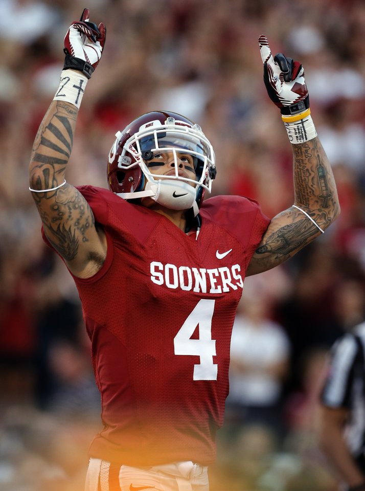 Photo - Kenny Stills (4) celebrates a touchdown during the college football game between the University of Oklahoma Sooners (OU) and the University of Kansas Jayhawks (KU) at Gaylord Family-Oklahoma Memorial Stadium in Norman, Okla., on Saturday, Oct. 20, 2012. Photo by Steve Sisney, The Oklahoman
