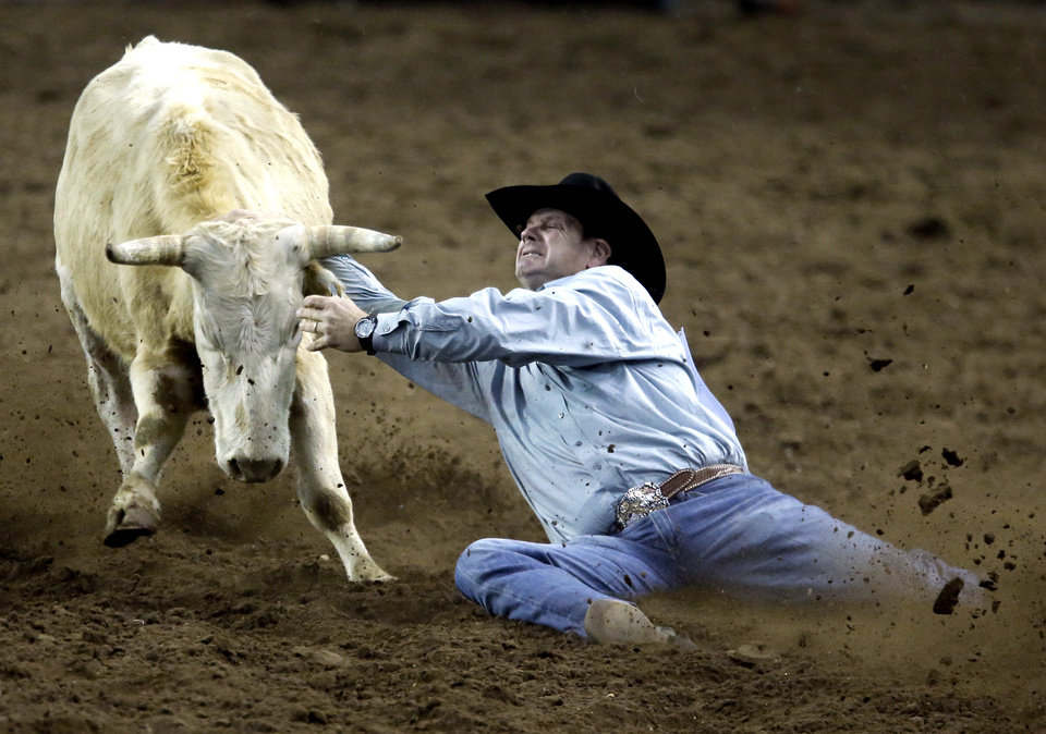 Photo - Brad Stewart of Mt. Ulla, North Carolina misses a steer during the International Finals Rodeo at the State Fair Arena in Oklahoma City, Friday, Jan. 17, 2014.  Photo by Sarah Phipps, The Oklahoman