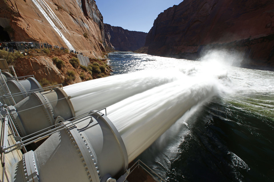 Interior Secretary Ken Salazar turned the valves that started the high-flow release of water into the Colorado River from bypass tubes at Glen Canyon Dam in Page, Ariz., Monday Nov. 19, 2012. Federal water managers began started a 5-day high-flow experimental release to help restore the Grand Canyon's ecosystem. (AP Photo/The Arizona Republic, Rob Schumacher) MARICOPA COUNTY OUT; MAGS OUT; NO SALES