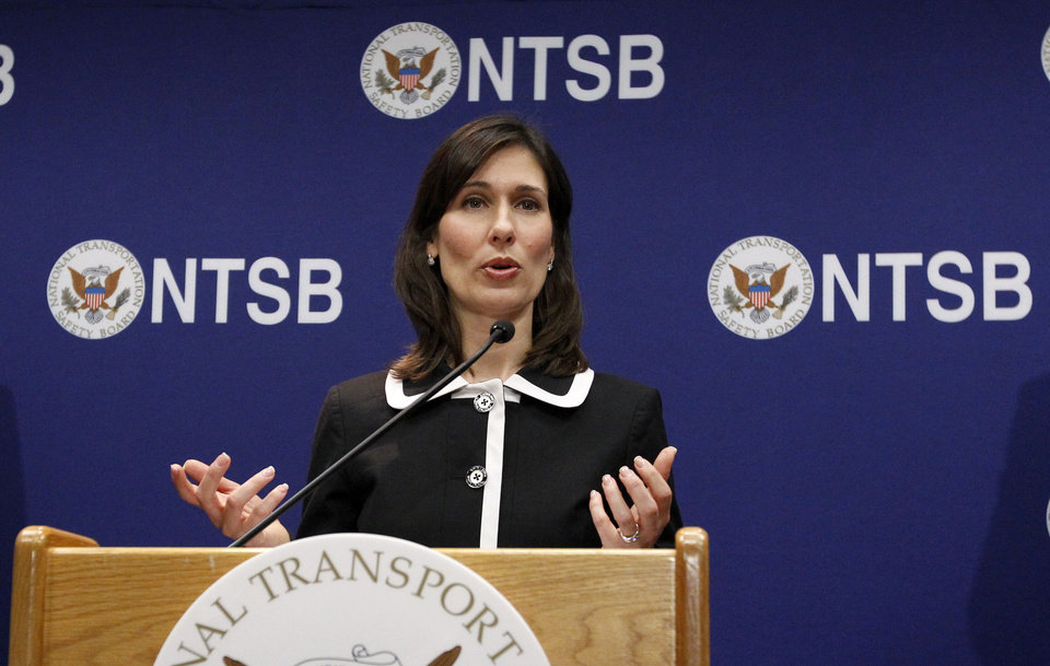 Photo - National Transportation Safety Board (NTSB) Chair Deborah Hersman gestures as she speaks during a news conference in Washington, Thursday,  Feb. 7, 2013, to provide an update on the NTSB's investigation into the Jan. 7 fire that occurred on a Japan Airlines Boeing 787 at Logan International Airport in Boston.  (AP Photo/Ann Heisenfelt)