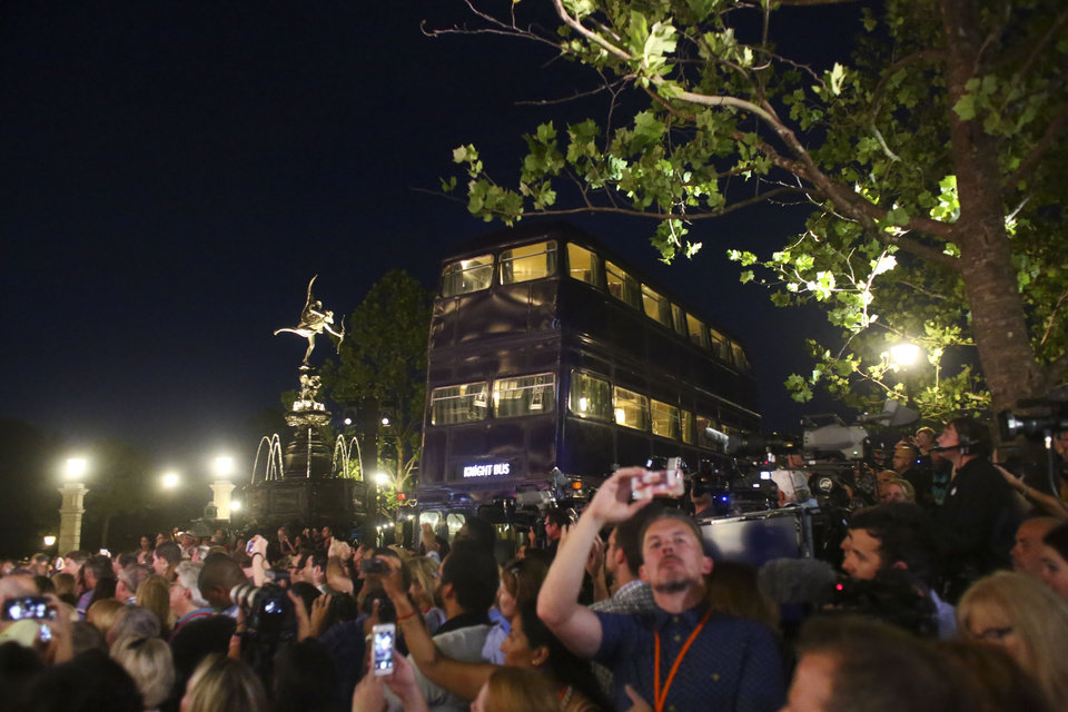 Photo - The Knight Bus is seen during the Wizarding World of Harry Potter Diagon Alley preview event at Universal Studios Florida in Orlando on Wednesday, June 18, 2014. Diagon Alley will officially open to the public on July 8, 2014.  (AP Photo/The Tampa Bay Times, Eve Edelheit)   TAMPA OUT; CITRUS COUNTY OUT; PORT CHARLOTTE OUT; BROOKSVILLE HERNANDO OUT; USA TODAY OUT;