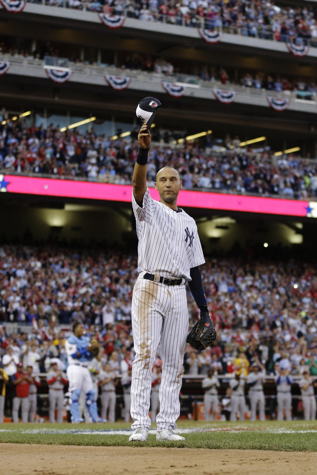 Photo - American League shortstop Derek Jeter, of the New York Yankees, waves as he is taken out of the game in the top of the fourth inning of the MLB All-Star baseball game, Tuesday, July 15, 2014, in Minneapolis. (AP Photo/Jeff Roberson)