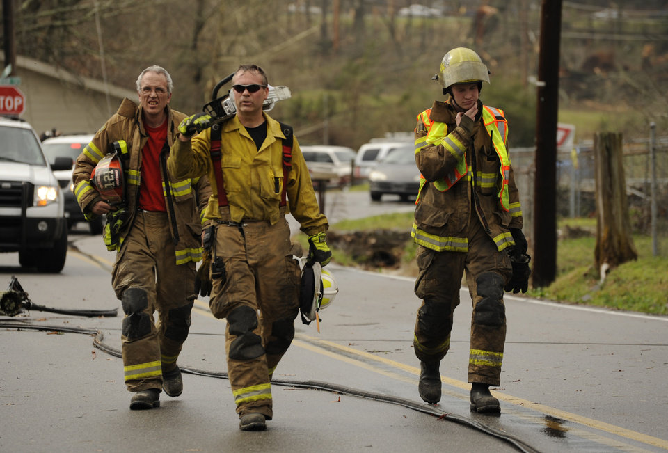 Fire crews make their way up Short Tail Springs Road after a tornado struck the area Friday, March 2, 2012 in Harrison, Tenn.  Powerful storms stretching from the Gulf Coast to the Great Lakes flattened buildings in several states, wrecked two Indiana towns and bred anxiety across a wide swath of the country in the second powerful tornado outbreak this week.  (AP Photo/Chattanooga Times Free Press, Ashlee Culverhouse) ORG XMIT: TNCHA116