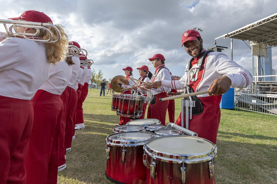 Photo - The Pride of Oklahoma Marching Band performs during the grand opening weekend of Scissortail Park in Oklahoma City, Sunday, Sept. 29, 2019. (Alonzo Adams for The Oklahoman)