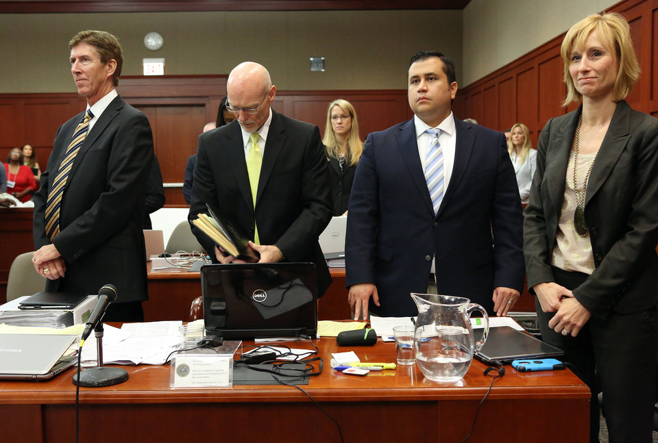 Defense attorneys, from left, Mark O'Mara, Don West and Lorna Truett, far right, stand with their client George Zimmerman, second from right, during Zimmerman's trial in Seminole circuit court in Sanford, Fla. Wednesday, June 26, 2013. Zimmerman has been charged with second-degree murder for the 2012 shooting death of Trayvon Martin.(AP Photo/Orlando Sentinel, Jacob Langston, Pool)
