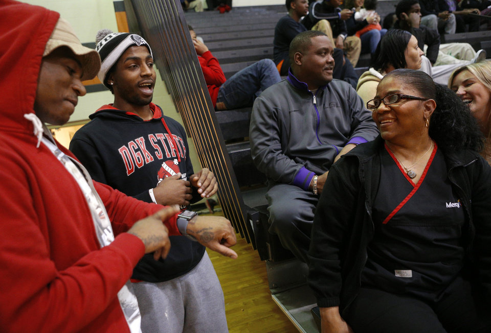 Photo - Dorshell Clark talks with her sons Dominique, left, and D'angelo Clark during her other son's, Deondre Clark's, basketball game at Douglass High School in Oklahoma City, Tuesday, January 28, 2014. Photo by Bryan Terry, The Oklahoman