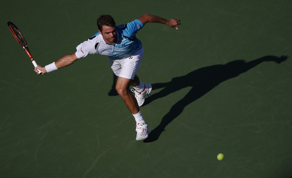 Photo - Stan Wawrinka, of Switzerland, chases down a shot by Jiri Vesely, of the Czech Republic, during the opening round of the 2014 U.S. Open tennis tournament, Monday, Aug. 25, 2014, in New York. (AP Photo/Elise Amendola)