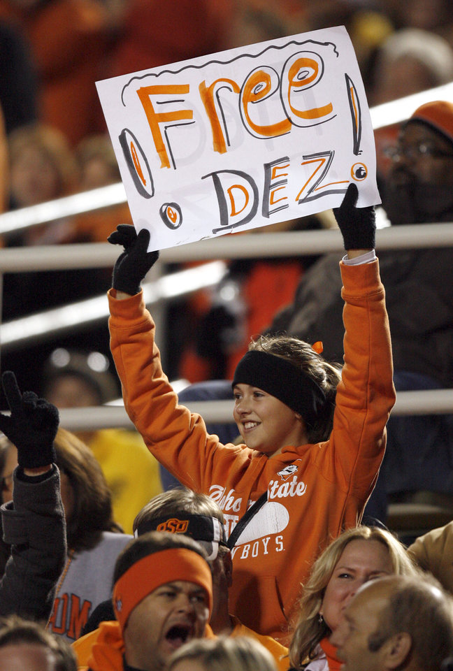 Photo - A fan shows her support to OSU's Dez Bryant during the college football game between Oklahoma State University (OSU) and the University of Missouri (MU) at Boone Pickens Stadium in Stillwater, Okla. Saturday, Oct. 17, 2009.  Photo by Sarah Phipps, The Oklahoman