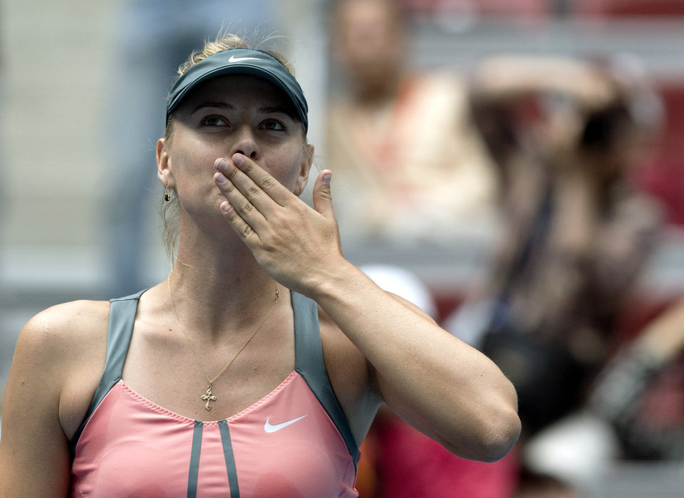 Photo -   Russia's Maria Sharapova blows kisses to the crowd after defeating Polona Hercog of Slovenia in their women's singles tennis match of the China Open tennis tournament in Beijing Thursday, Oct. 4, 2012. Sharapova won 6-0, 6-2. (AP Photo/Andy Wong)