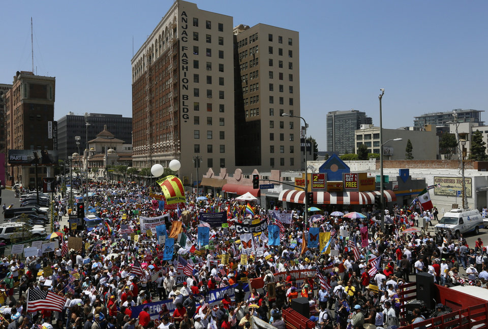 Thousands of people march during a May Day rally in downtown Los Angeles on Wednesday, May 1, 2013. In celebration of May Day, people have gathered across the country to rally for various topics including immigration reform. (AP Photo/Damian Dovarganes)