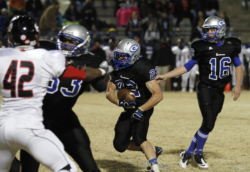 Photo - Guthrie's Luke Davis (22) runs the ball during a high school football game between Guthrie and East Central at The Rock in Guthrie, Friday, Nov. 18, 2011.  Photo by Garett Fisbeck, The Oklahoman