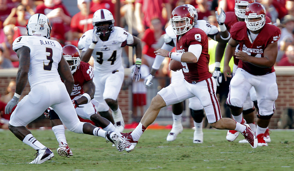 Oklahoma\'s Trevor Knight (9) looks for running room past Louisiana Monroe\'s Cameron Blakes (3) and Michael Johnson (34) during the college football game between the University of Oklahoma Sooners (OU) and the University of Louisiana Monroe Warhawks (ULM) at the Gaylord Family Memorial Stadium on Saturday, Aug. 31, 2013 in Norman, Okla. Photo by Chris Landsberger, The Oklahoman