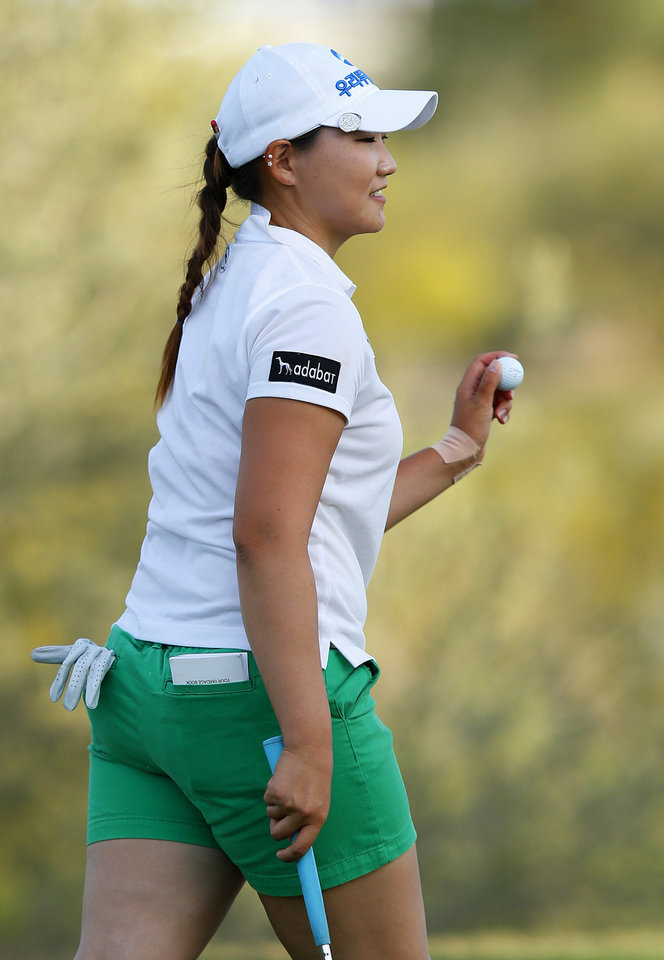Photo - Mirim Lee, of South Korea, smiles as she waves to the cheering crowd with her golfball after finishing her final round of the LPGA Founders Cup golf tournament on Sunday, March 23, 2014, in Phoenix.  Lee finished tied to second place at 18-under par. (AP Photo/Ross D. Franklin)