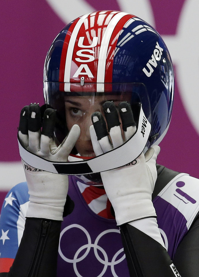 Photo - Summer Britcher of the United States prepares to start a run during the women's singles luge training at the 2014 Winter Olympics, Sunday, Feb. 9, 2014, in Krasnaya Polyana, Russia. (AP Photo/Michael Sohn)