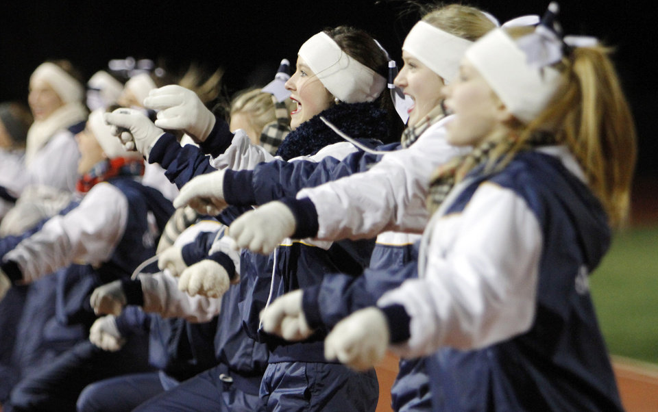 Heritage Hall cheerleaders peform  a cheer on the sideline during the Class 3A high school football semifinal playoff  game between Heritage Hall and Bethany at Putnam City High School in Oklahoma City, Saturday, December 4, 2010. Photo by Nate Billings, The Oklahoman